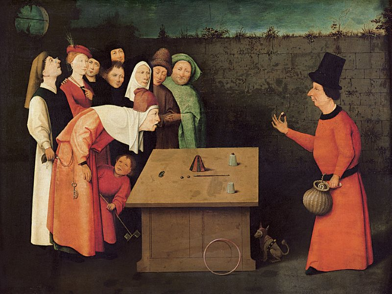 The real trick is happening where you're not looking. 'The conjurer' by Hieronymus Bosch, painted between 1496 and 1520, is now at the Musée Municipal, Saint-Germain-en-Laye, France. Photo: Public Domain / Wikimedia.