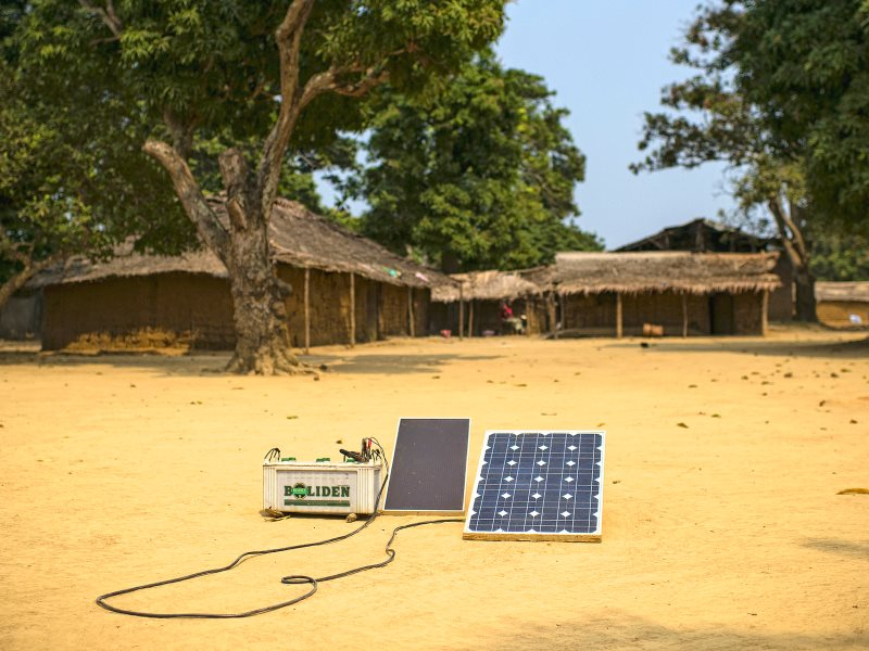 Solar cell charging a battery. Lukolela, Democratic Republic of Congo. Photo: Ollivier Girard / Center for International Forestry Research (CIFOR) via Flickr (CC BY-NC-ND).