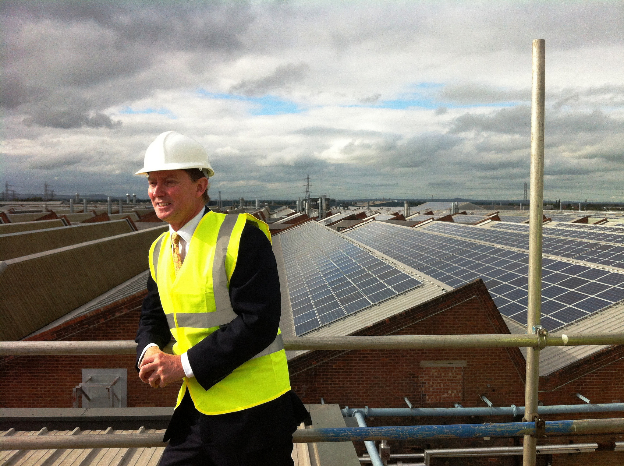 Minister Gregory Barker visits what was then the UK's largest rooftop solar array at Bentley Motors in Crewe, October 2013. Photo: DECC via Flickr (CC BY-ND).