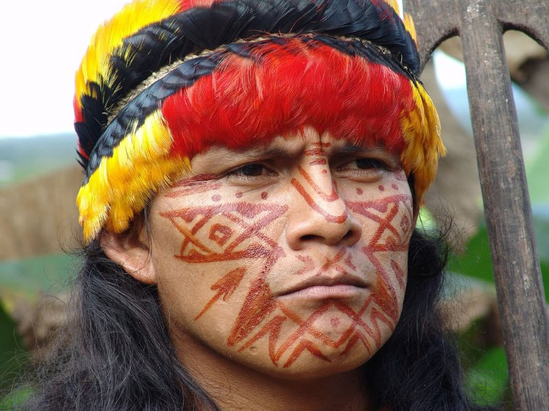 Portrait of Shuar Indian in Ecuador's Amazon, where gross violations of human and environmental rights have been committed by oil companies. Photo: 00rini hartman via Flickr (CC BY-NC-SA).