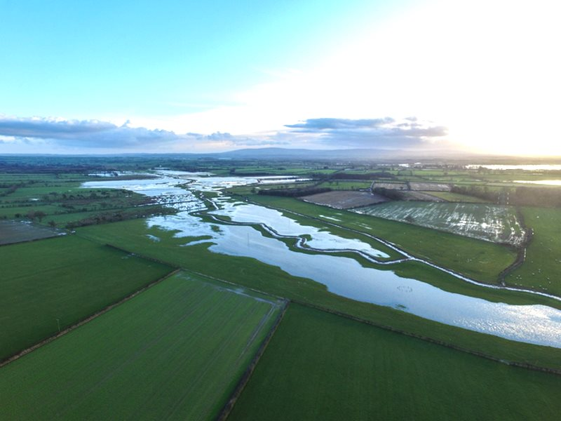 Flooded, embanked tributary of the River Eden in Cumbria. Image from a small unmanned aerial vehicle. Photo: Neil Entwistle @salfordhydro .