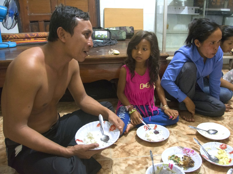 Ven Vorn enjoyed dinner with his family and friends in Koh Kong City shortly after his release from prison. Photo: Rod Harbinson.