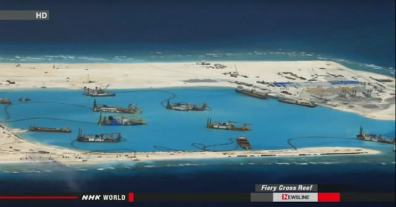 Once a coral reef, now a construction site. China expanding its land 'reclamation' at Fiery Reef in the South China Sea. Photo: still from report by NHK WORLD NEWSLINE English (see video embed).