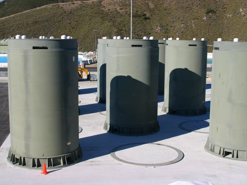 Dry casks for storing irradiated nuclear fuel at the Diablo Canyon plant in Avila, California. The plant is scheduled to close within a decade, but taxpayers will pay to keep spent fuel stored on-site until a federal repository is ready to take it. Photo: