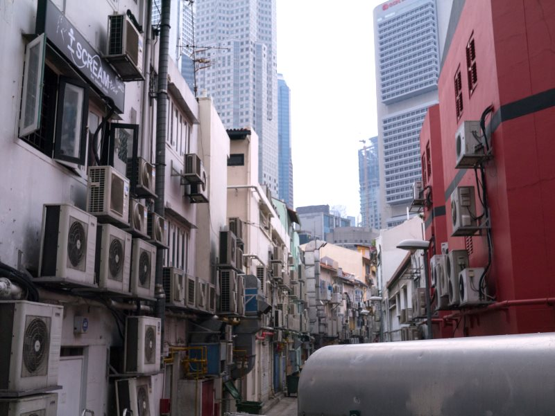 The HFC gases that run most of the world's heat pumps and air conditioners, like these ones in Singapore, are very powerful greenhouse gases. But now the world has agreed to solve the problem. Photo: Rym DeCoster via Flickr (CC BY).