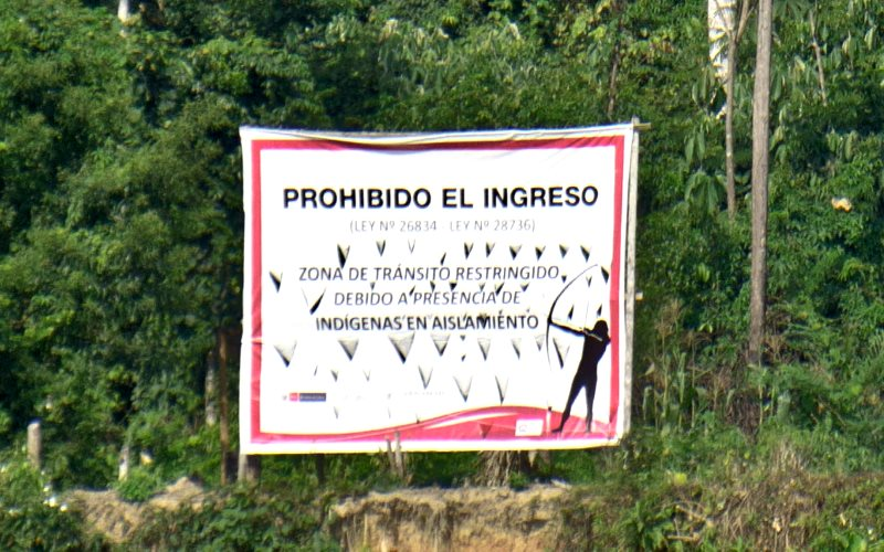 'Entry forbidden - Law number 26834 - Law number 28736 - Zone of restricted access owing to the presence of indigenous peoples living in isolation'. Sign in the Manu National Park, Peru. Photo: oarranzli via Flickr (CC BY-ND).