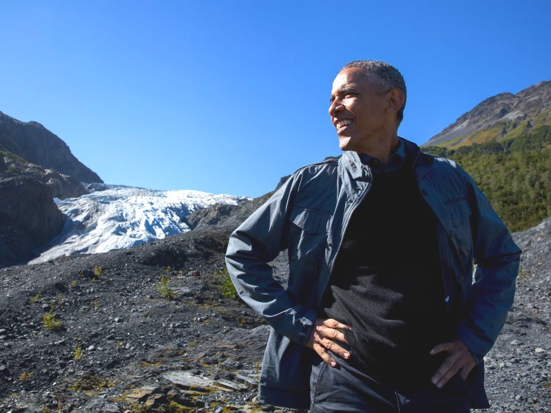 Will Obama's clean energy legacy outlast this Alaskan glacier? Chances are it may. President Obama stops for a break in Kenai Fjords National Park with Exit Glacier in the background. Photo: Pete Souza / The White House (Public Domain).
