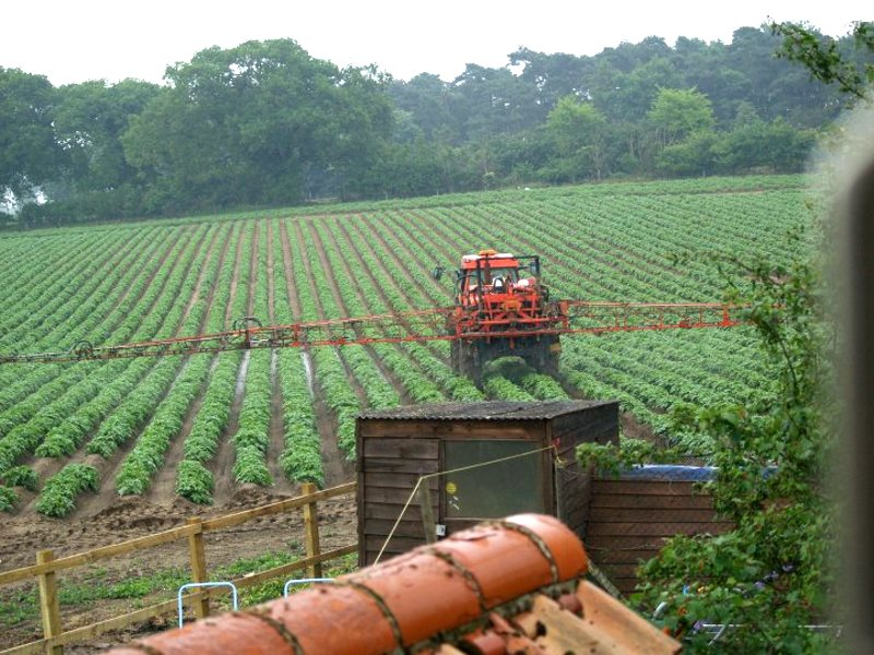 Pesticide spraying taking place just over the garden fence of a British home. Photo: UK Pesticides Campaign.