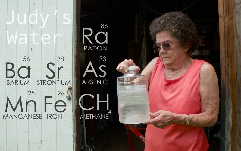 Judy Eckert holding water contaminated with arsenic drawn from her private well 450ft from a fracking rig in Pennsylvania, which she believes contaminated her water supply. Photo: Public Herald via Flickr (CC BY-NC-ND).