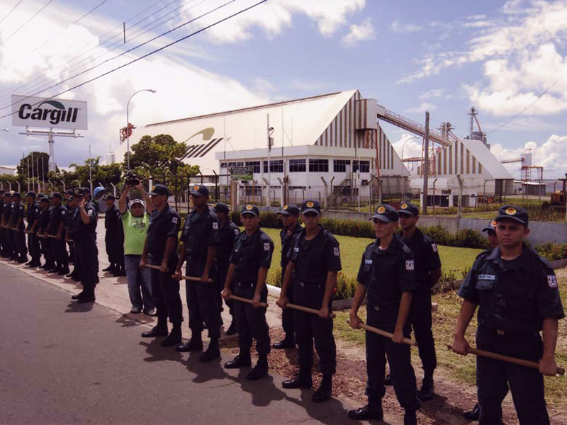The Santarem Cargill compound is surrounded by guards during a protest