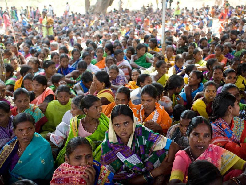 Tribal women gather listen to speeches at bijepur at a protest against