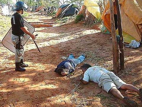 An encampment of landless rural people is violently expelled by police in Paraguay.