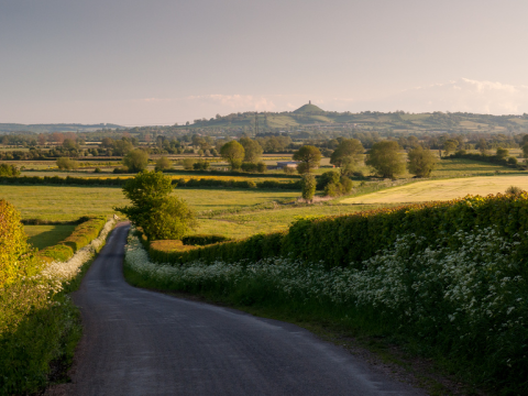 View over the Somerset Levels to Glastonbury Tor. Photo: Joe Dunckley via Flickr.com.