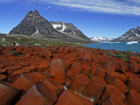 Oil drums dumped at a former US air force base on the  Ikateq channel, Greenland. Photo: banyanman via Flickr.com.