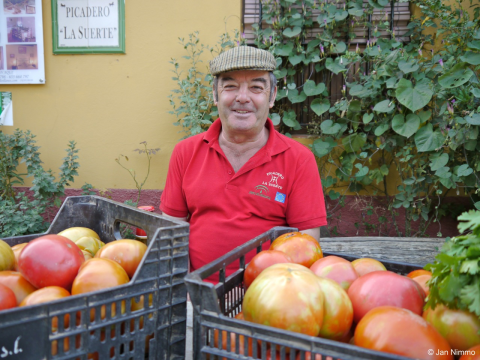 Iluminado Tristancho and some of his homegrown organic tomatoes Photo:Jan Nimmo.