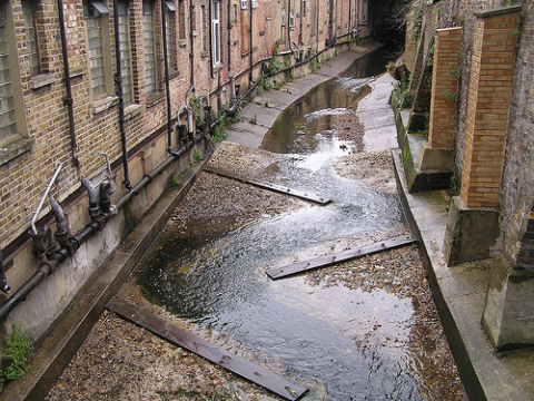 Small changes to this narrow channel on the river Quaggy between buildings have improved habitat quality and water aeration. Photo: Ashley Basil / Quaggy Waterways Action Group - QWAG.org.uk - via Flickr.com.