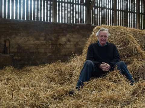 Peter Melchett enjoys a roll in the organic hay at Courtyard Farm in Norfolk. Photo: Peter Melchett.