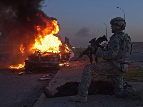 Sgt. Shane Chapman yells for a medic to treat an Iraqi civilian injured in a car bomb in Mosul, Iraq, 2008. Photo: US Air Force / Staff Sgt. Jason Robertson via Flickr.