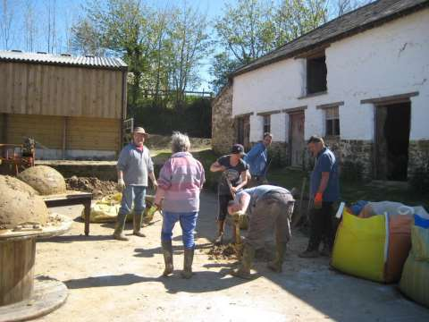 Mixing the cob in our farm yard. Photo: Smallholder Training.