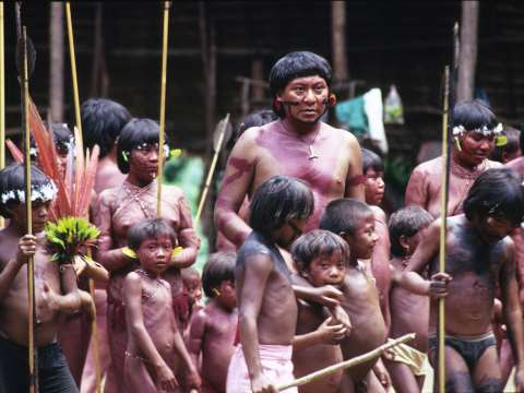 Davi Koponawa at home in the forest among his people. Photo: Survival International.