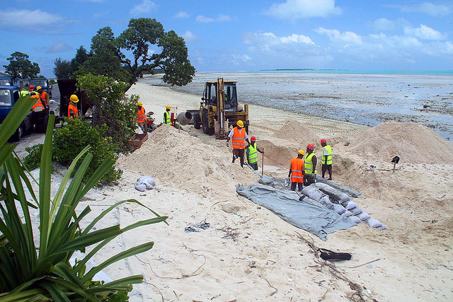 A sea wall is built in Kiribati to protect against rising seas. But migration is also essential in building local resilience to climate change. Photo: Global Environment Facility via Flickr.
