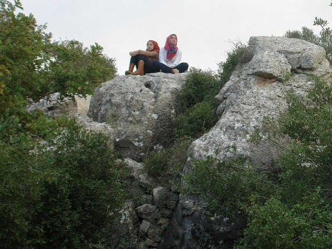 Girls perch on a massive rock at Juthour.