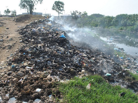 Aglogbloshie - pollution from E-waste pollutes a water course. Photo: qamp.net via Flickr.
