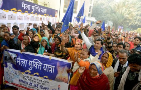 Lalibai (holding right side of banner) helped to organise a march of 10,000 women who have left manual scavenging through 18 states to Delhi, where they won important legal changes. Photo: © 2012 Rashtriya Garima Abhiyan.