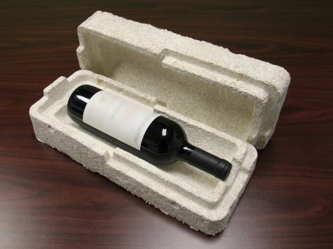 A wine bottle pack made from farm and forestry waste, bound together by fungal myceliae. Photo: Ecovative Design.