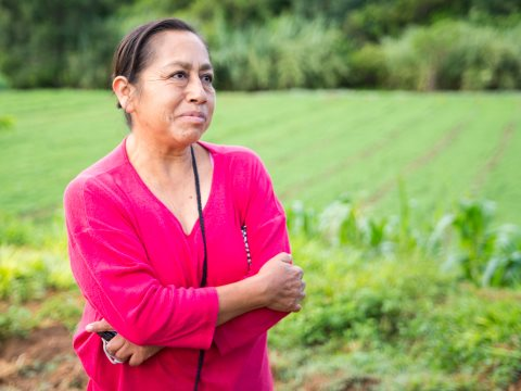 Alba Garcia stands in front of her fields of corn and amaranth. Photo: Anna Bruce.