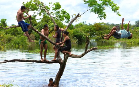 An indigenous community at play in an Amazon tributary near Iquitos, Peru. Photo: André Thiel via Flickr.