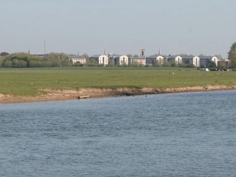 View towards the development from Port Meadow, completely eclipsing Oxford;s 'dreaming spires'. Photo: cover of the EIA.