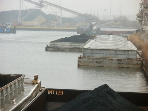 Barges loaded with petcoke on the Calumet River. Photo: Southeast Environmental Task Force.