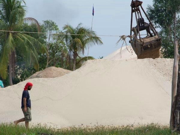 Sand mining of rivers is decimating fishstocks. Mother Nature has expanded its campaigning to take on the powerful sand barons. Here Alex shoots one of his much watched videos at a sand mining operation in Koh Kong province. Photo: Rod Harbinson.