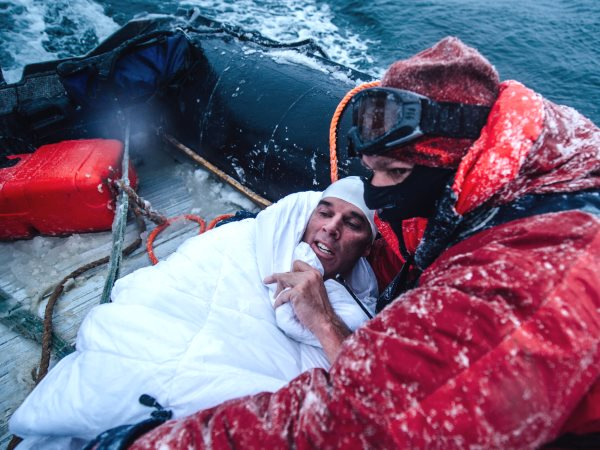 Lewis Pugh recovering on his support boat after swimming 500m in water with a temperature of 0°C off the coast of Peter I Island in the Bellinghausen Sea - one of 13 seas which surround Antarctica. Photo: lewispugh.com.