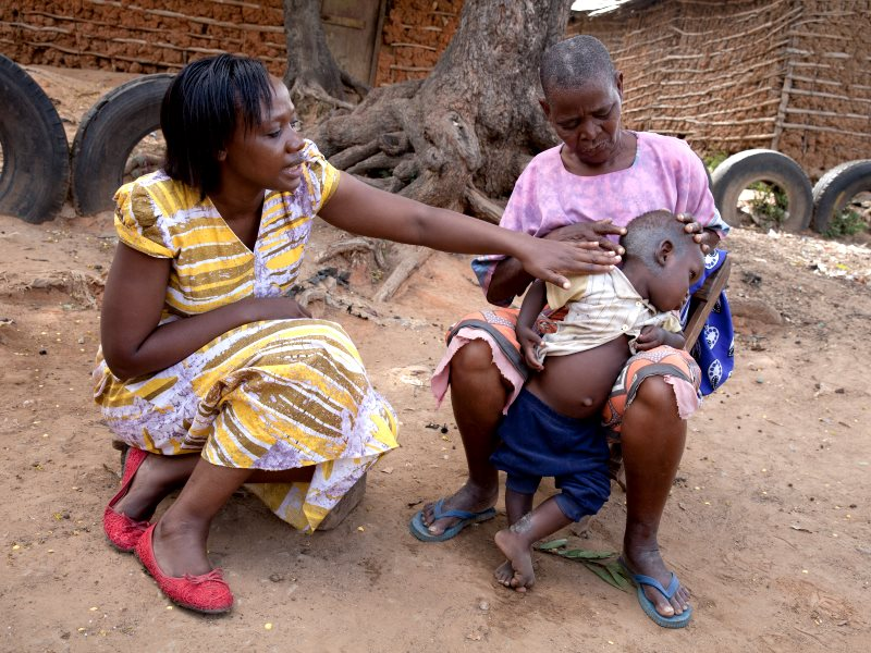 Phyllis Omido meets a woman whose grandson is suffering from lead poisoning. She is building a court case to hold the Kenyan government to its commitment to clean up the contaminated site and provide care for local residents. (Photo: Goldman Environmental
