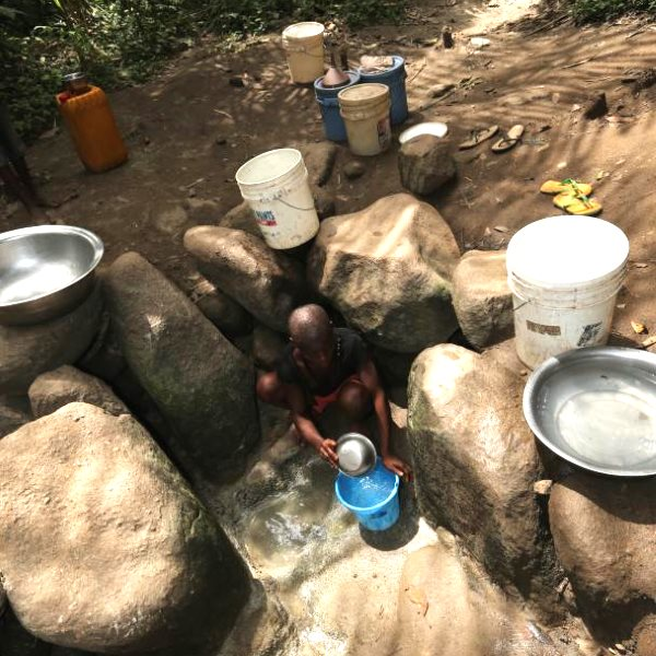 In Betem, Nigeria, farmers were forced to dig out this alternative water source after their existing supply was polluted by Wilmar and rendered undrinkable. Photo: FOEI / ERA.