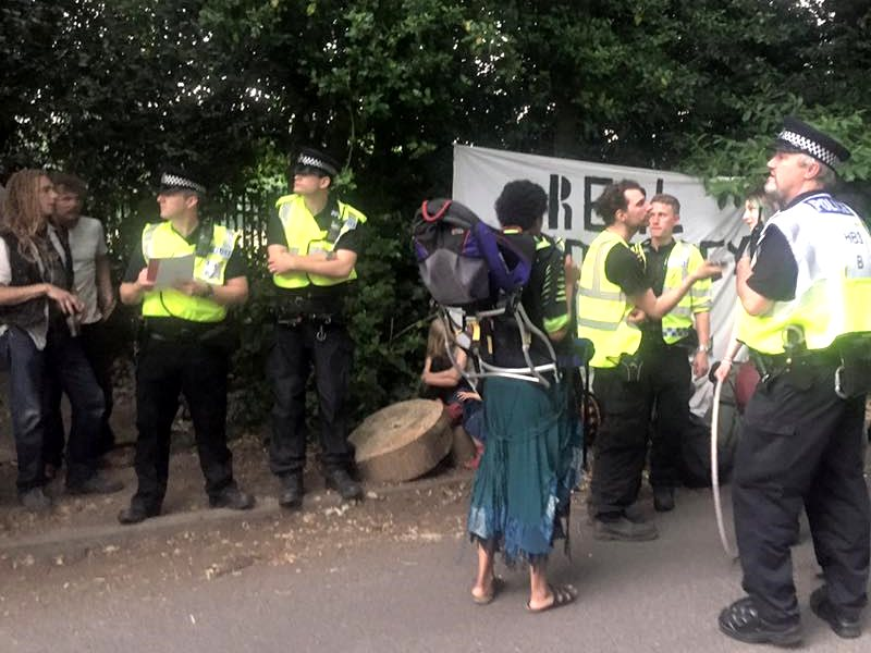 Police attempting to prevent people from attending the Democracy Festival near Runnymede yesterday. Photo: John Phoenix via Facebook.
