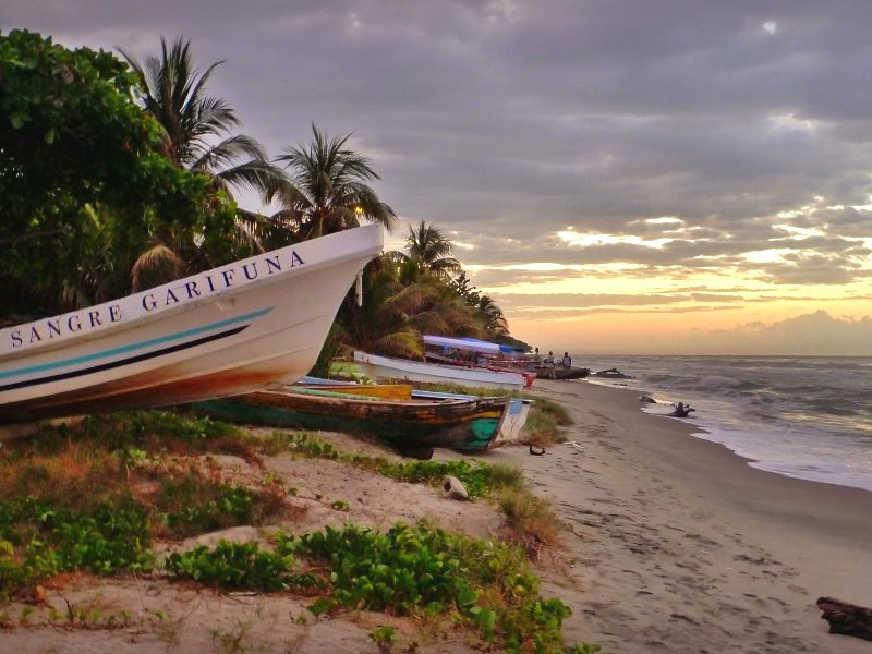 'Sangre Garifuna' - Sunset along the coast of Sambo Creek, Garifuna, Honduras. Photo: Andrew Hall via Flickr (CC BY-NC-SA).