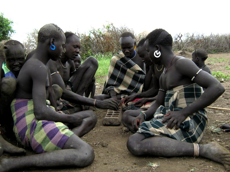 Mursi men playing gabata. Photo: Will Hurd.