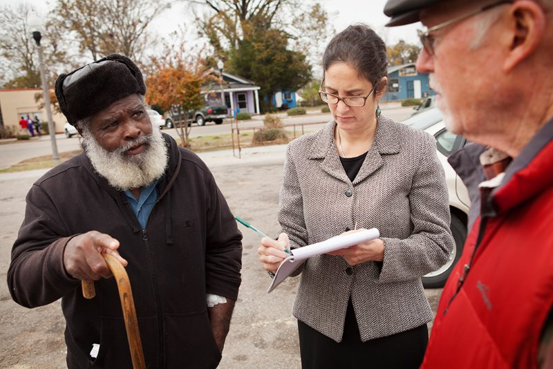 Attorney Engelman Lado, center, and Episcopal Reverend Tom Brown, right, speak with A.C. Brown in downtown Uniontown, AL. Engelman Lado interviewed local residents, including Brown, about coal ash pollution. Photo: Chris Jordan-Bloch / Earthjustice.