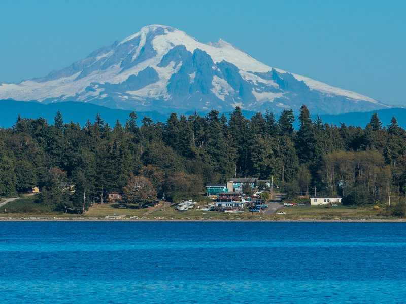A small community nestled by the sea, Mount Baker standing majestically behind. Photo: Lummi Island Wild.