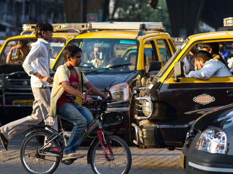 A lone boy on bicycle negotiating an evening traffic Jam in Mumbai. Photo: Adam Cohn via Flickr (CC BY-NC-ND).