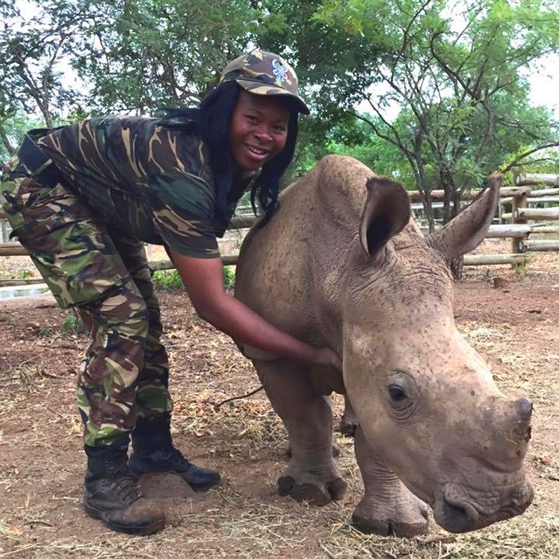 A Black Mamba with Orphan Rhino at Rhino Revolution. Photo: Jade Aldridge.
