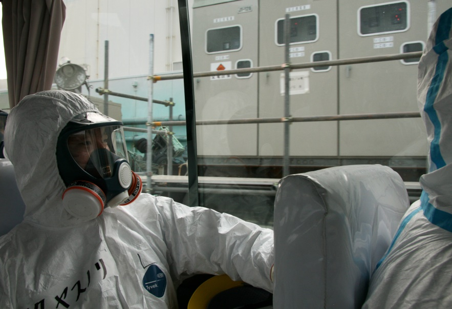 Scientists visiting the Fukushima Dai-ichi Nuclear Power Plant back in 2011 had to wear protective equipment but the Government insists that surrounding areas are now safe. Photo: IAEA Imagebank via Flickr (CC BY-SA 2.0)