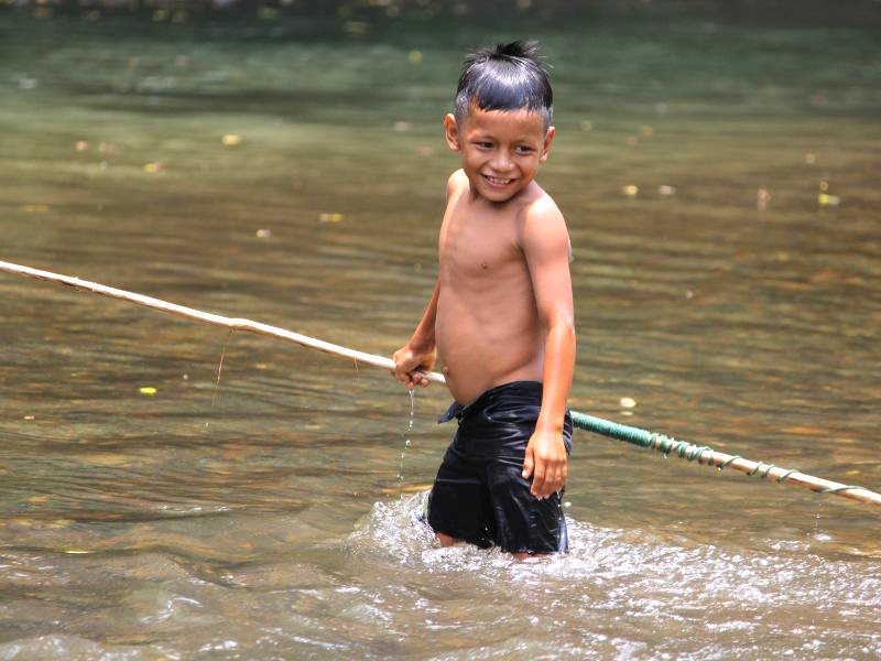 A indigenous boy fishing near Sarayaju, Ecuador. Photo: Kevin Koenig / Amazon Watch.