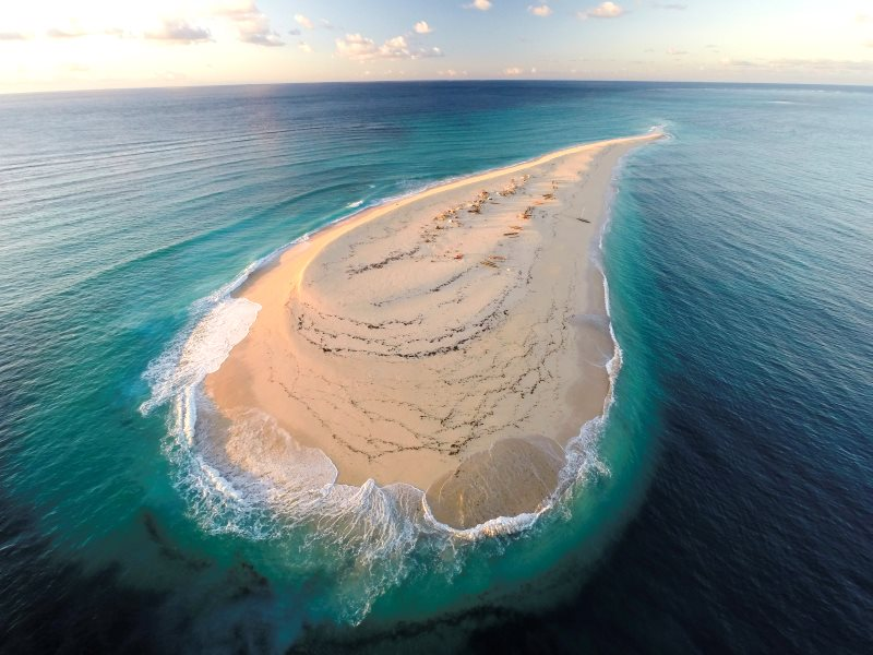 A sand cay in the Barren Isles. Some of the islands have no fresh water and are completely inundated in the highest tides, but their rich waters may nevertheless attract hundreds of migrant fishers who live there for months at a time. Photo: © Garth Crip