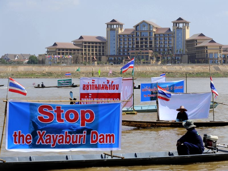 ​Boat flotilla from Thai NGOs and communities ​protesting the Xayaburi ​Dam, Laos, 2012. Picture taken from the Thai side of the Mekong, facing conference centre. Photo: International Rivers.