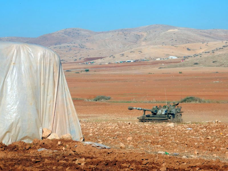 A tank near a tent in the community. Photo: 'Aref Daraghmeh, B'Tselem, 12 Nov. 2015.