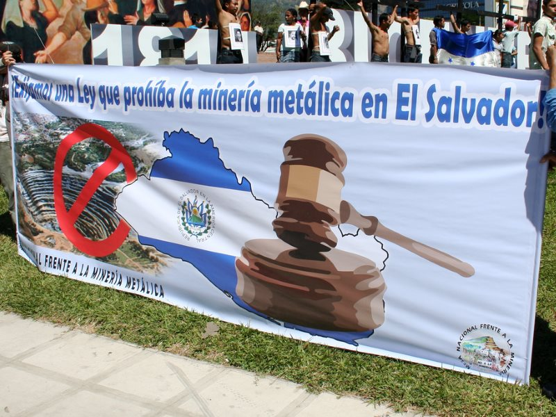 'We demand a law that prohibits metallic mining in El Salvador!' - banner at protest action, 22nd March 2011. Photo: laura via Flickr (CC BY).